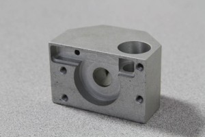 An aluminum part, cut by a CNC machining center